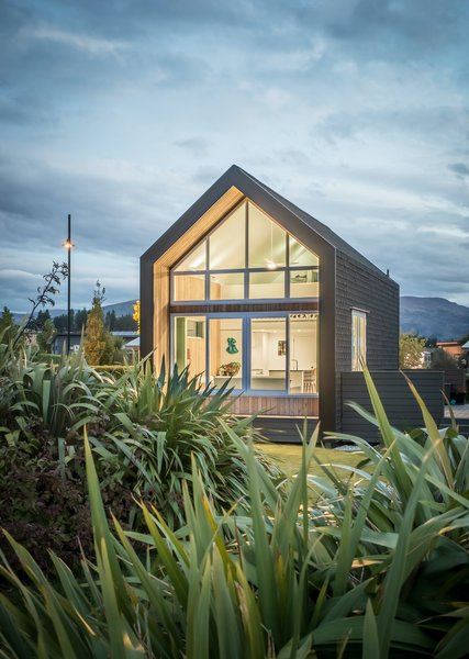 The home is defined by a simple gable form clad in asphalt shingles and larch weatherboards. With a combination of passive house measures and structural insulated panels, virtually no additional energy is required to maintain a consistent level of thermal comfort against the backdrop of the unforgiving New Zealand alpine climate.