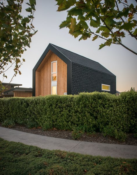 """""""I love the simple gabled form with its contrasting claddings with the dark asphalt shingles contrasting with the warmth of the wood,"""" says architect Barry Condon."""