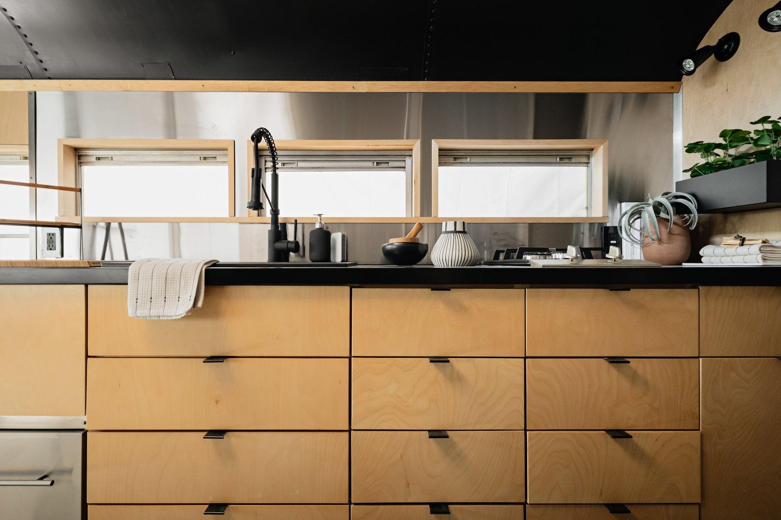 Kitchen of Scandinavian Skoolie by Killdisco Design.