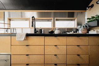 The Corian countertop in the kitchen and the bespoke timber kitchen cabinets and breakfast bench were the most expensive parts of the build-out.