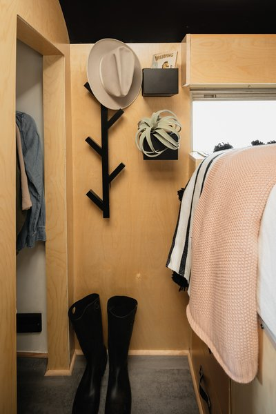The master bedroom features built-in under-bed storage, and it's adjacent to a surprisingly large wardrobe.