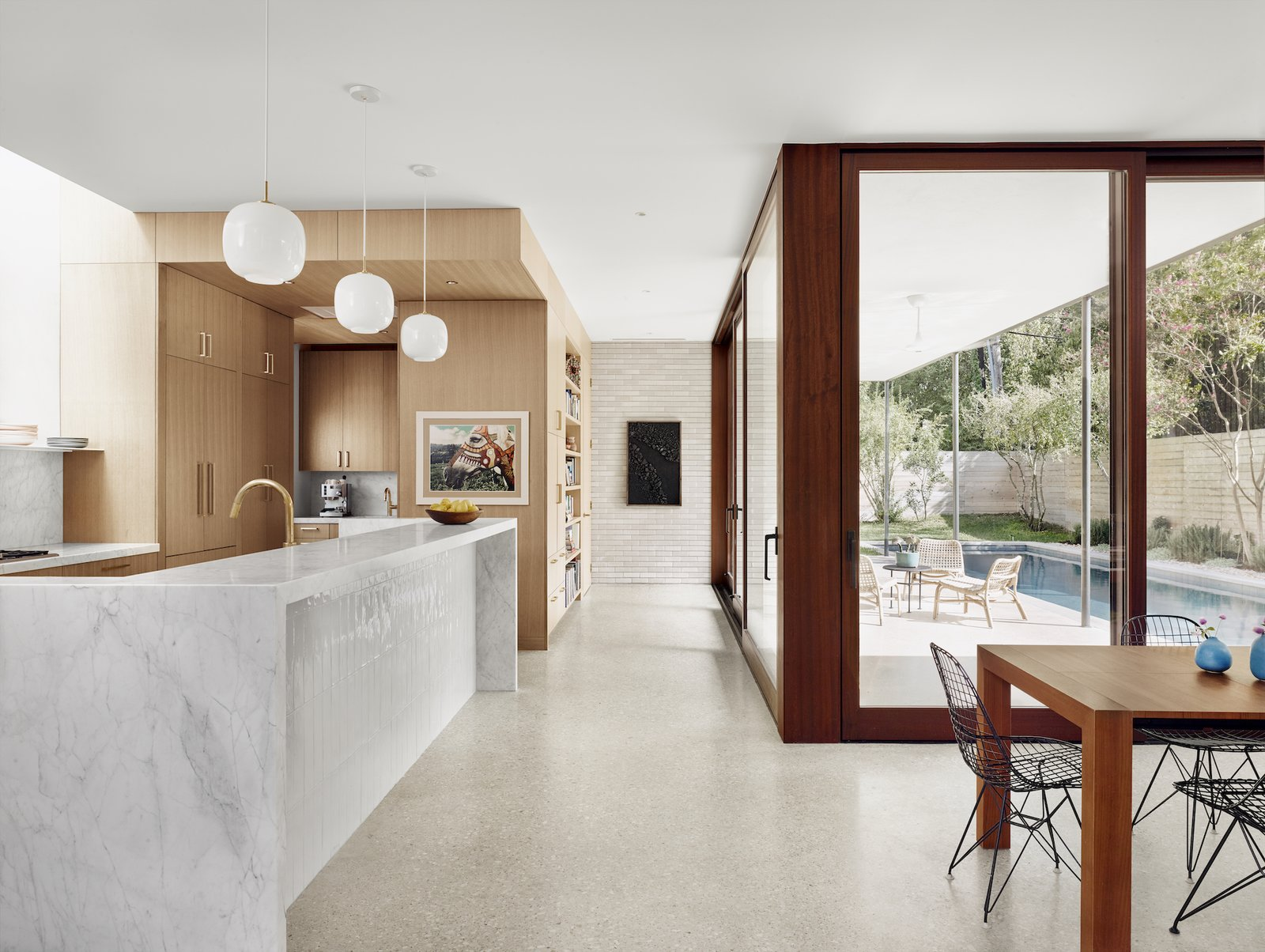 Kitchen and dining area at Hemlock Ave. House by Chioco Design.