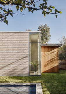 The majority of the house is clad in earth-tone modular brick. The brick was chosen for its durability, low maintenance, and the texture and pattern it lends to the elevations.