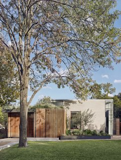 """The simple composition of the new house is inspired by midcentury modern homes. Instead of demolishing the old house, the couple decided move it to a new location a few miles away. """"After all, there was no reason to put twenty odd tons in a landfill, especially since it had good structural integrity,"""" says designer Jamie Chioco. """"It could make a good first-time home for someone just as it did for me"""""""