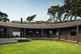 The relationship between the house and the circular grass lawn is key to the way the home sits in the landscape. Architect Belinda George gave much consideration to the way the steps lead up to the deck.