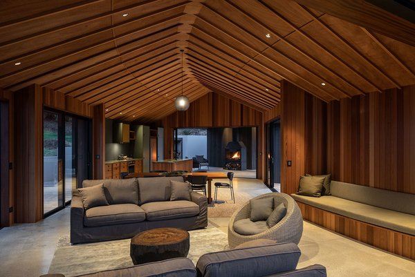 A long bench seat is built into the rear wall of the living room, allowing for various seating configurations and a relaxed atmosphere.