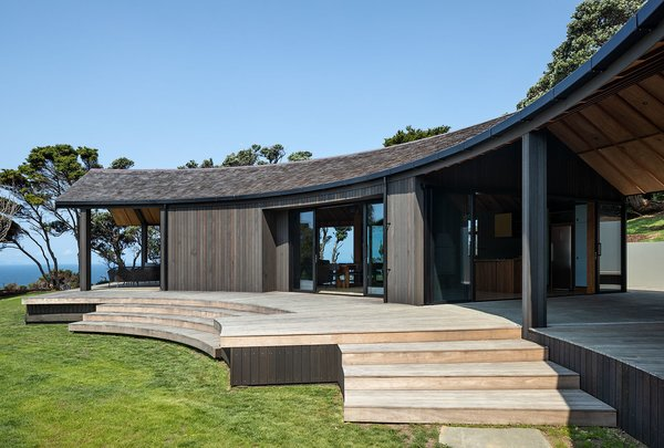 The home features more covered deck space than interior living space, evoking a feeling of living in the landscape.