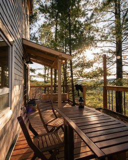 The deck, which overlooks the uninterrupted forest, has been left uncovered so the inside of the house receives ample natural light throughout the year.
