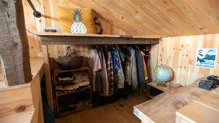 A small, open wardrobe space is also located on the second floor, next to the editing studio and the raised loft bedroom.