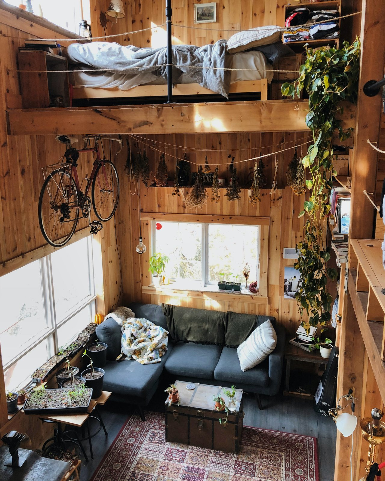 Living room and bedroom of Canadian Castaway Off-Grid Cabin.