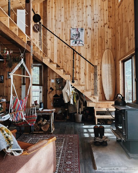 "The owner wanted to achieve a simple and rustic aesthetic throughout the home, with a focus on raw materials. ""I didn't want to paint the wood white, for instance,"" he says. ""I just wanted to let it age naturally and invite it to mirror the natural world it was now a part of."""