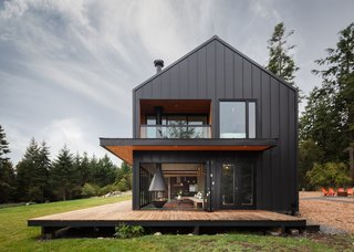 Both the main house and the cabins were designed to bring the outside in, celebrating a connection with the surrounding forest. The expansive deck on the main house almost doubles the usable square footage, blurring the barrier between the interior and exterior.