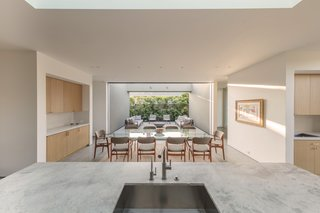 """Public interior and exterior spaces have been arranged to enable free flow from one space to another,"" says Joseph. ""One can feel the total length and width of the property by standing at the heart of the home, the kitchen island."""