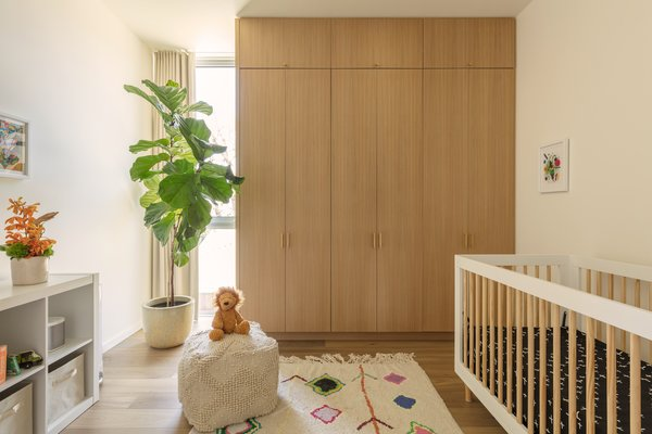 The nursery on the first floor is situated directly above the guest bedroom on the ground floor. The two bathrooms are also stacked to allow for efficient structural, mechanical, and plumbing systems.