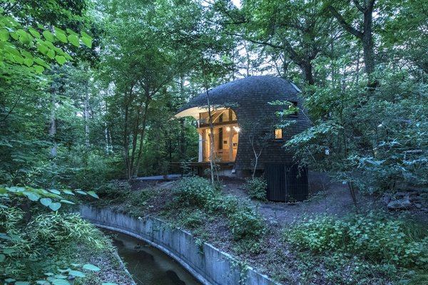 "Organic lines mimicking those in nature can be soothing. Architect Tono Mirai, known for his ""earth architecture,"" was inspired by the lush context for the design of this holiday home in Nagano, Japan."