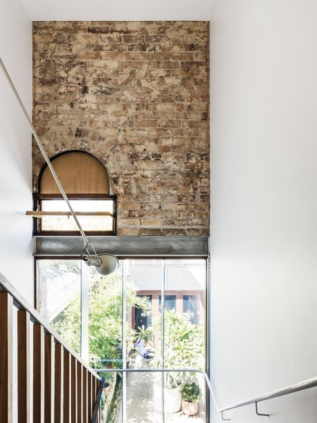 "The handrail is a 18-millimeter pipe with curved junctions that was all welded on site and fixed to the surrounding walls. ""It took some time to set out and position the stair,"" reveals Joe. ""As it is in the original part of the house, there isn't a wall or surface that is truly square and plumb!"""