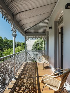 "The balcony—with iron lacework that is typical of an inner Sydney terrace—is the only real nod to strict heritage conservation in the project. ""We were required to replicate the original design of the balcony,"" says Joe. ""Curiously, it was the first job we undertook and the last to be completed."""