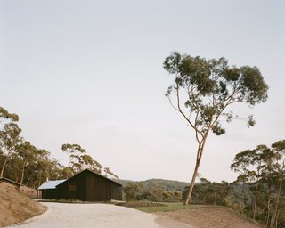 """The home was designed as a retreat for architect Roger Nelson and his wife Jane, a teacher of yoga. """"We were very involved in the process, as once the 'building documentation' was complete we administered the project,"""" says Roger. """"It's a space for us to unwind and relax alone or with family and friends."""" Ironbark timber was selected for the exterior cladding due to its high BAL (Bushfire Attack Level) rating."""
