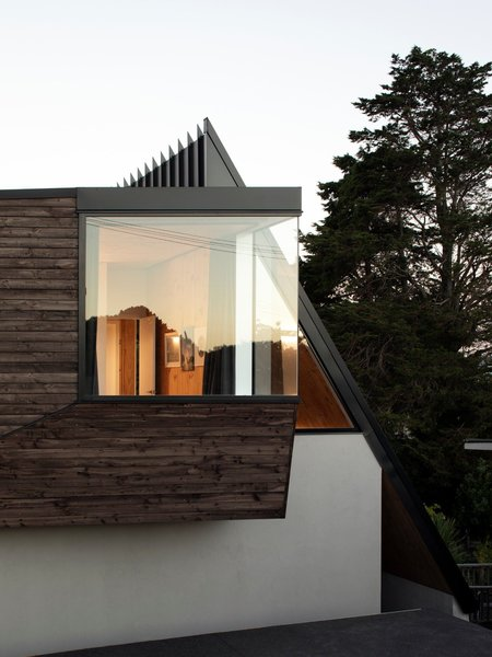 """The sharply angled roof balances the fragmented form of the home at the front. """"We called the roof the 'shark's fin roof' when we were designing it,"""" says Craig. """"It offers a formal counterpoint to the mass of the upstairs, but uses a sharp angle to create a dynamic form as the building goes down the site."""""""