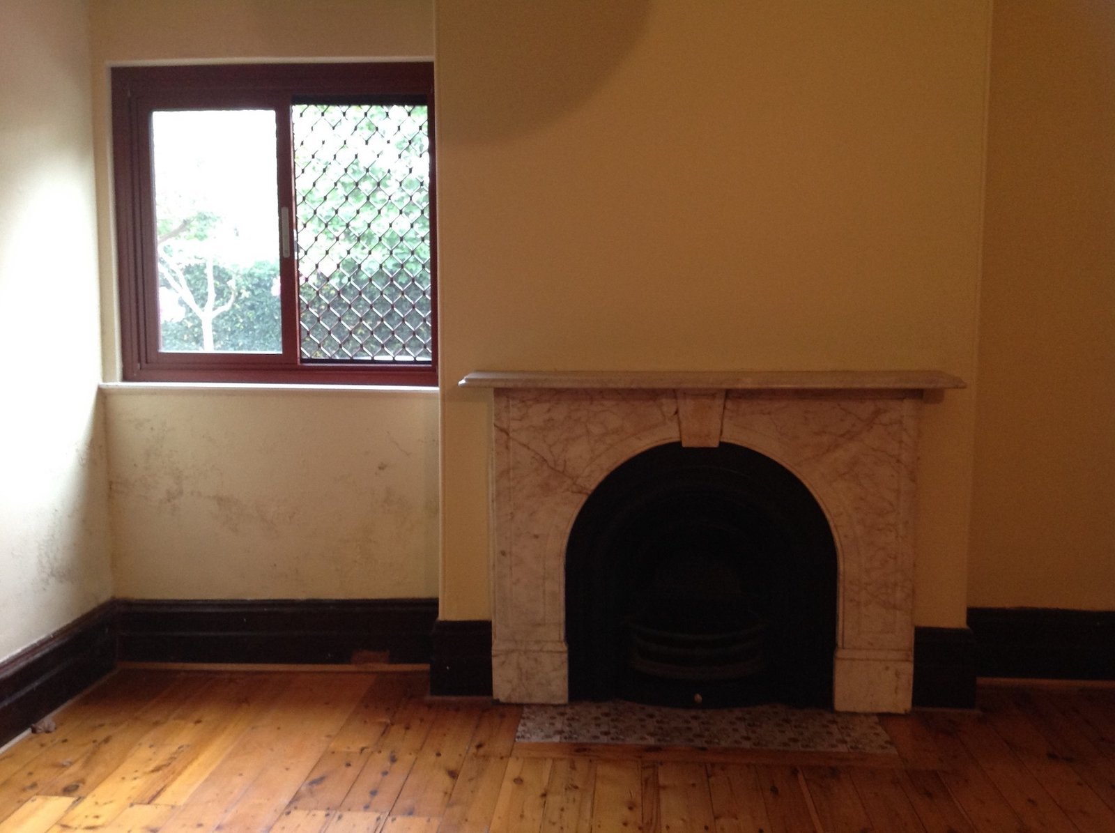 Before: Like the lounge room, the dining room before the renovation was relatively dark with small windows.  Photo 14 of 37 in Before & After: A Blighted Boarding House in Sydney Is Now an Adaptable Courtyard Home