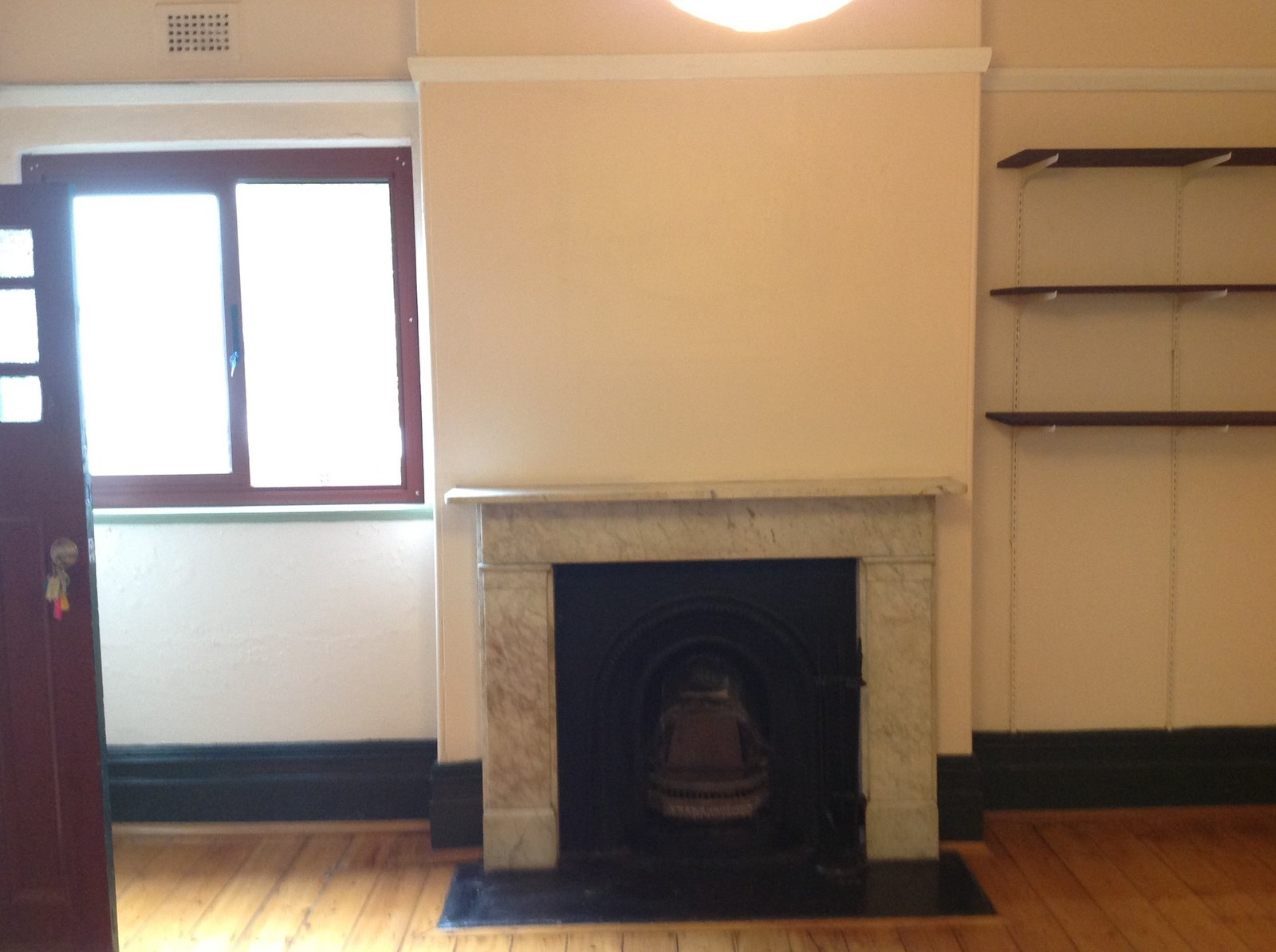 Before: The guest bedroom before the renovation. As in other rooms in the front wing, the original fireplace has been restored.  Photo 23 of 37 in Before & After: A Blighted Boarding House in Sydney Is Now an Adaptable Courtyard Home