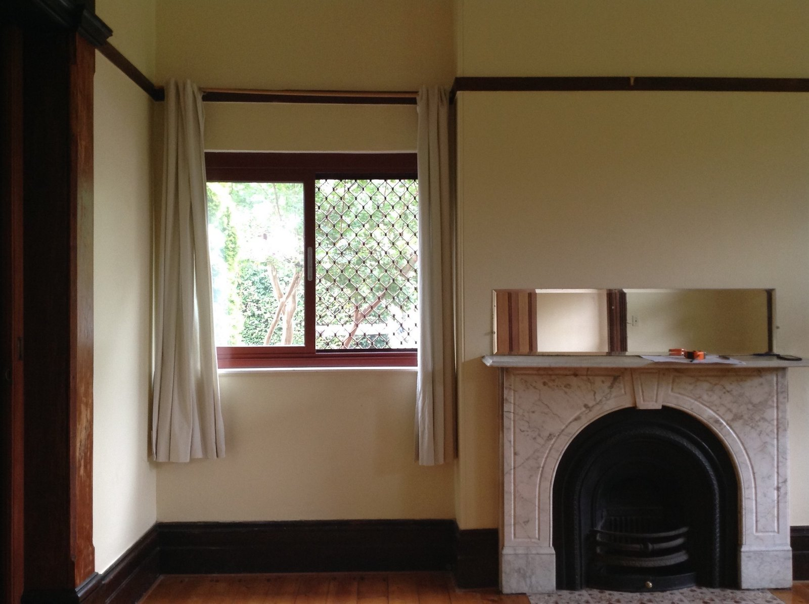 Before: The small windows in the original lounge, located at the front of the home beside the entrance, minimized the amount of natural light to the interior.  Photo 11 of 37 in Before & After: A Blighted Boarding House in Sydney Is Now an Adaptable Courtyard Home