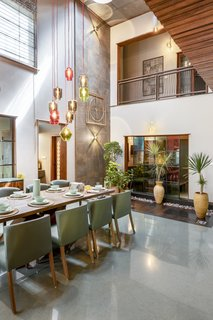 """The dining room features a number of potted plants in a """"dry courtyard"""" that echoes the greenery in the outside living spaces."""