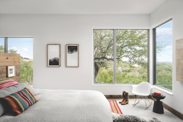 The east side of the house—the secondary residence—is set back from the master bedroom in the primary residence so that it has direct sunrise views through corner glazing.