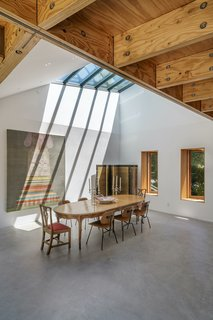 """The geometric shape of the roof was driven by the desire to capture a """"perspective view"""" out into the landscape, through both windows and skylights. """"The volumes of the roof extend that view out into the landscape,"""" says architect Peter Tolkin. """"The angle and shape of these various views were all connected, which is how the shape of the roof structure got produced."""" As a result, each volume has a unique shape and section."""