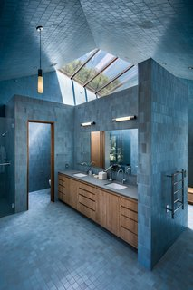 "The handmade tiles used to clad the wet areas are by Heath Ceramics. ""It was definitely a splurge,"" says architect Peter Tolkin. ""I thought that there would be something very powerful about having these colorful, enclosed volumes. It's almost like being inside of a ceramic vessel."""