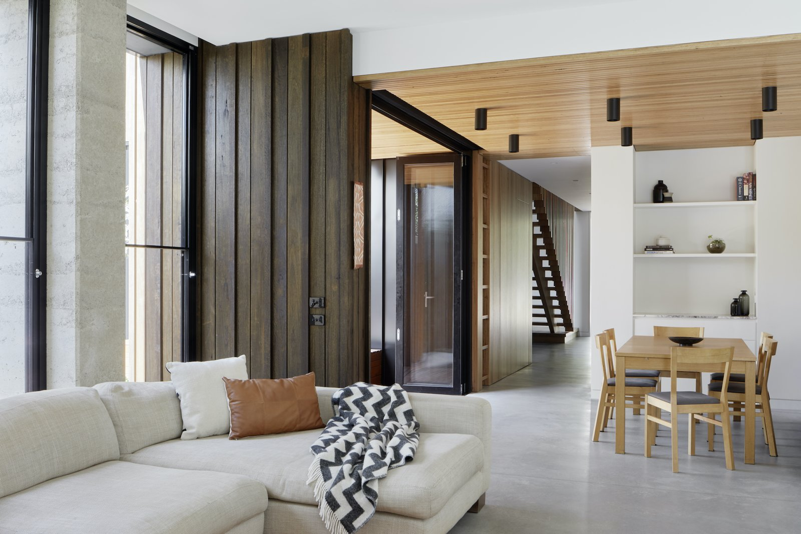Living and dining of Laurel Grove by Kirsten Johnstone Architecture.