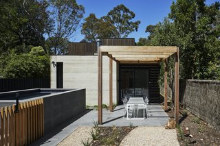 """I designed the pool as a form related to the house, but almost stepping down in scale,"" says architect Kirsten Johnstone. ""Australia's strict regulations around pools create challenges to achieve compliance. Here, we have used some timber battens and continuous bluestone paving to connect the pool to the entertaining area."" The garden is planted with drought-tolerant indigenous plants to support local wildlife."