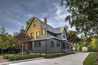 The exterior of the home takes inspiration from the old farmhouses and agricultural buildings of the Midwest, but with a more simple, contemporary finish in dark grey.