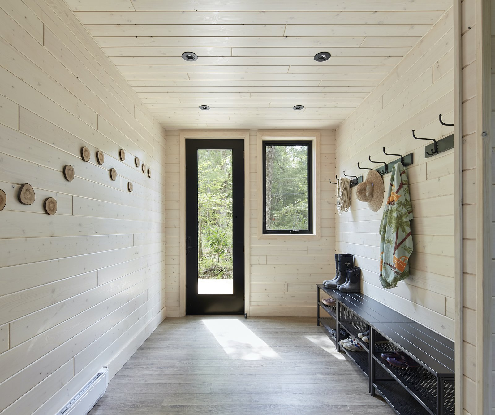 Entry hall of Kahshe Lake Cottage by Solares Architecture.