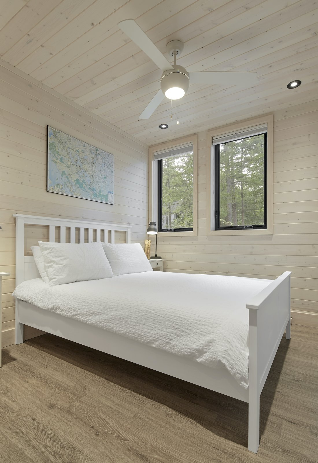 Bedroom of Kahshe Lake Cottage by Solares Architecture.