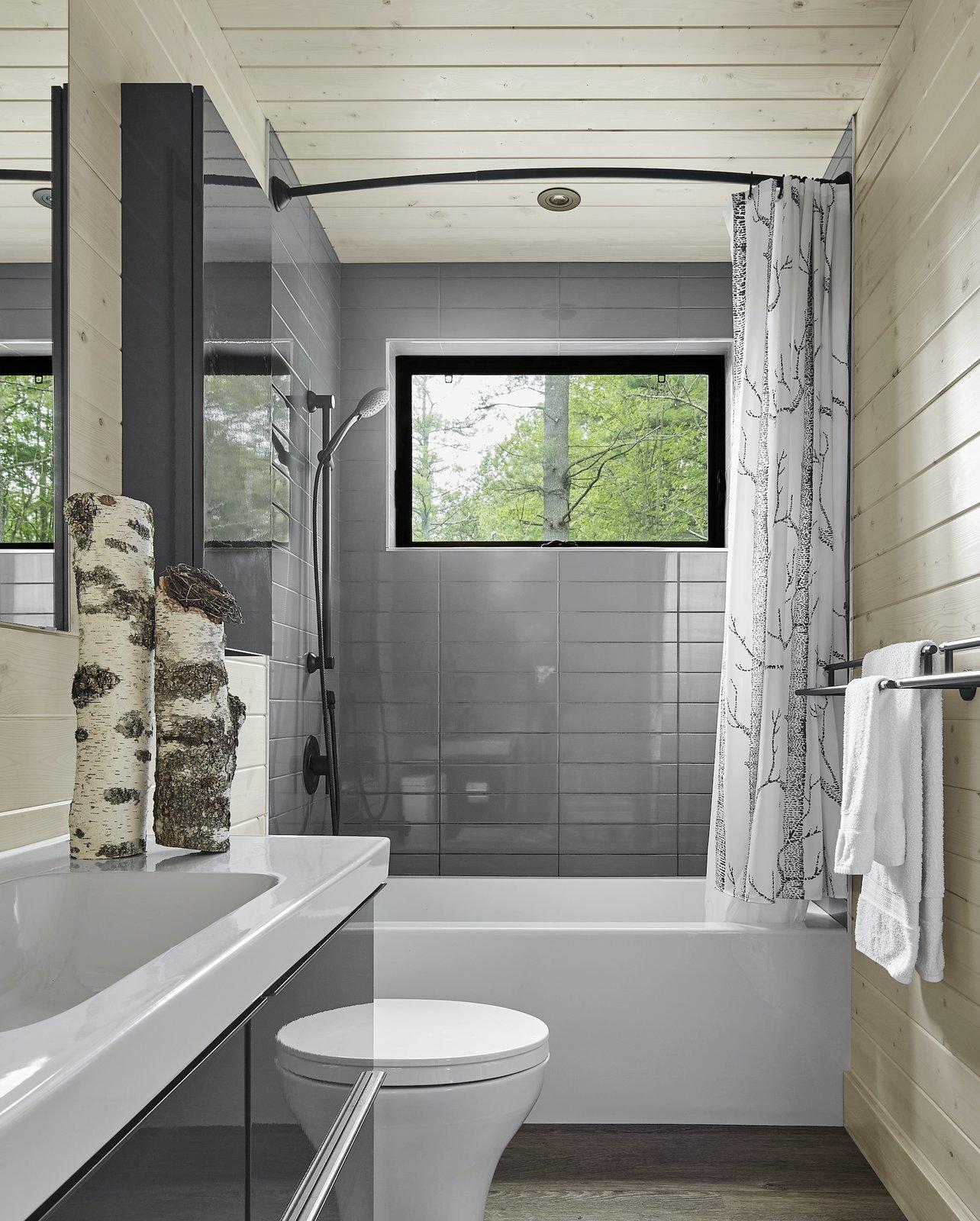Bathroom of Kahshe Lake Cottage by Solares Architecture.