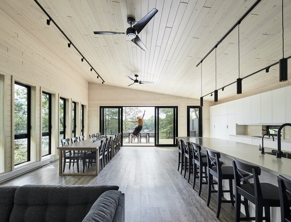 """The upper floor is completely open, and it's supposed to feel like you're in a big, really nice tent,"" says architect Tom Knezic. ""It does feel that way when you have all these windows on the south, and the sliding doors on either end of the hall open. You get the breeze through the space, and feel like you're outside."""