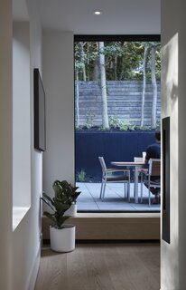 "The clients both work from home in the office space, which opens out into the backyard and is located in the more private rear of the home. The entire space can be closed off by a door in the hallway to provide added privacy and acoustic isolation. ""They work outside in the summer,"" says architect Trevor Wallace. ""The backyard is an oasis—it goes up a ravine and there's tonnes of trees and it's really quiet."""