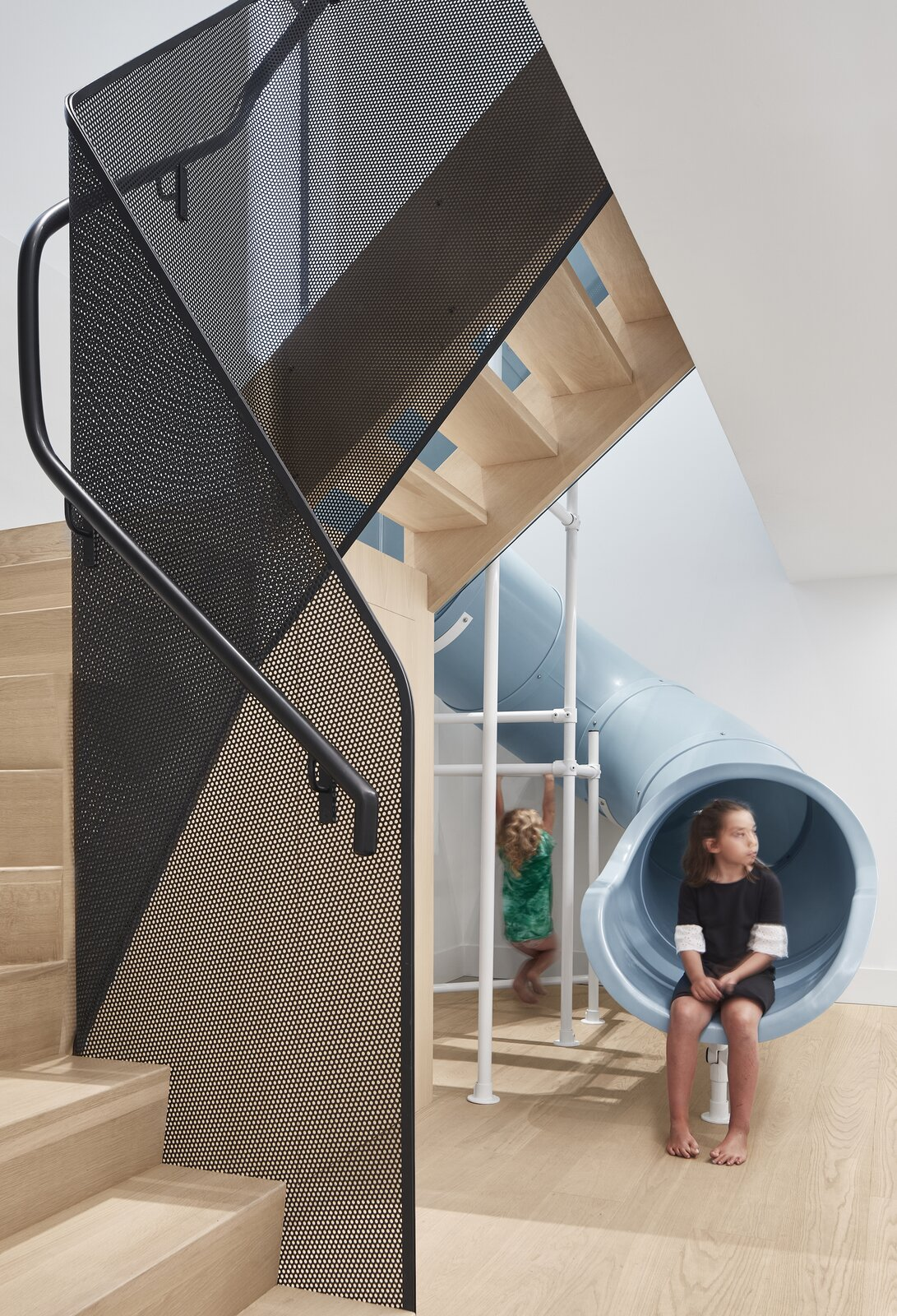 Stair and slide of Walker Residence by Reflect Architecture.