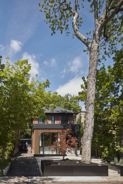 """The brick home had a previous addition at the front that was modified during the renovation. """"The client was keen on a heavy black aesthetic and we were worried it might feel very heavy, especially as it is the community-facing element of the building,"""" says architect Trevor Wallace. """"So, we lightened it up and made it feel a bit warmer with the timber screen."""""""