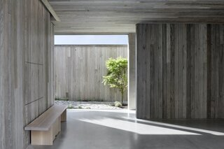 The brief called for the same timber to be used for the cladding internally and externally, with no visible treatment. As a result, the architects specified a pre-aged, recycled timber that inspired the name of the home—Silver Linings.