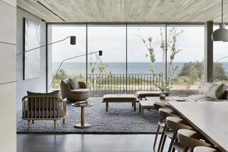 "The living room on the first floor is the main family gathering space. ""It is the collection zone for togetherness, and offers an abundance of natural light and extended views out to the bay and beyond,"" says architect Tony Vella."