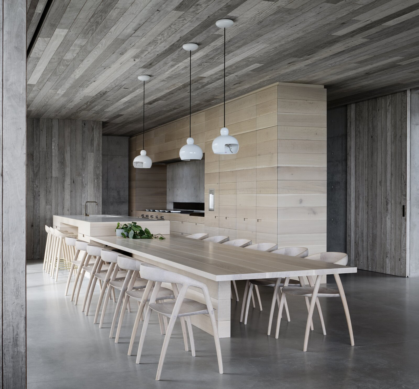 Dining and kitchen of Silver Linings by Rachcoff Vella Architects.