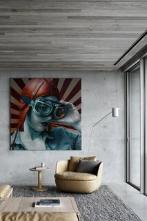 The artwork in the first-floor living room is by contemporary figurative artist Kathrin Longhurst. Colorful pieces, such as the artwork and furniture, bring a sense of vibrancy into the otherwise minimal home.