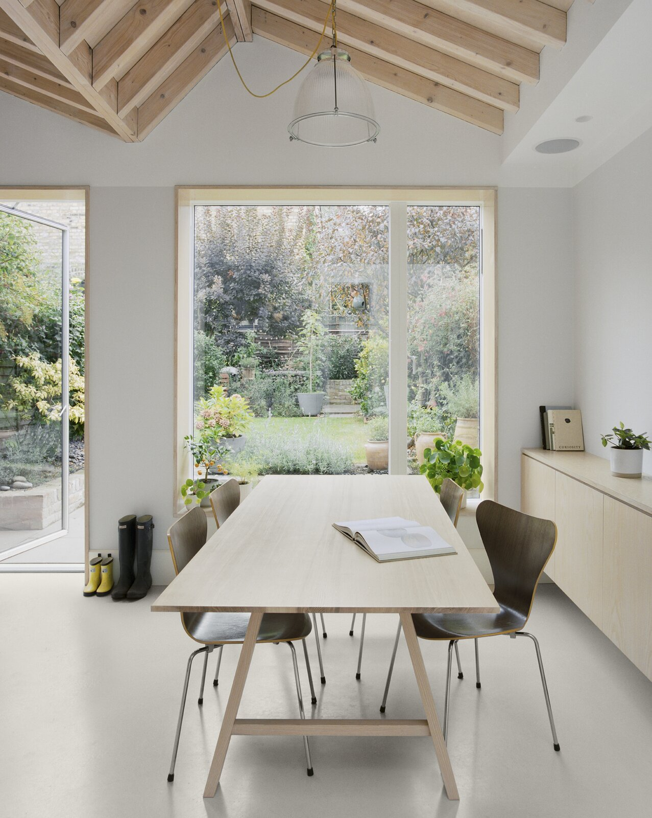 Dining area of Zigzag Roof House by 4 S Architecture.