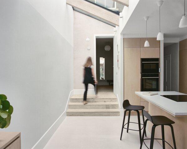 The light-filled extension opens out from the narrow hallway that runs through the home from the front door.