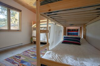 The second bedroom features bunk beds that allow the cabin to accommodate extended family holidays and gatherings.