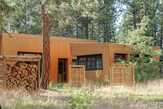 """David has built a number of screens and fences around the two cabins to increase privacy. """"We now have a good feel of rustic isolation,"""" says Diane."""