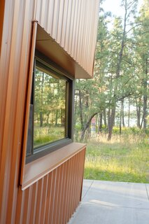 """We call the cabin TreeGazer because we are always amazed at how close to the forest we feel inside,"" says Diane. ""Although it is small, the cabin has big windows, and every view is a close view of trees."""