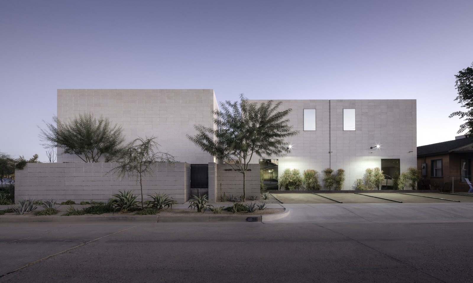 Exterior of White Stone Flats by Benjamin Hall Design.